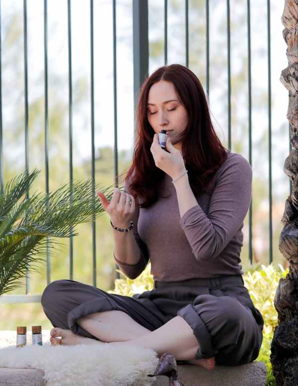 Woman smelling bottle of xinerqi lavender essential oil